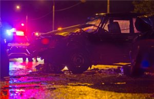 Night road car accident. Car crash in police lights.