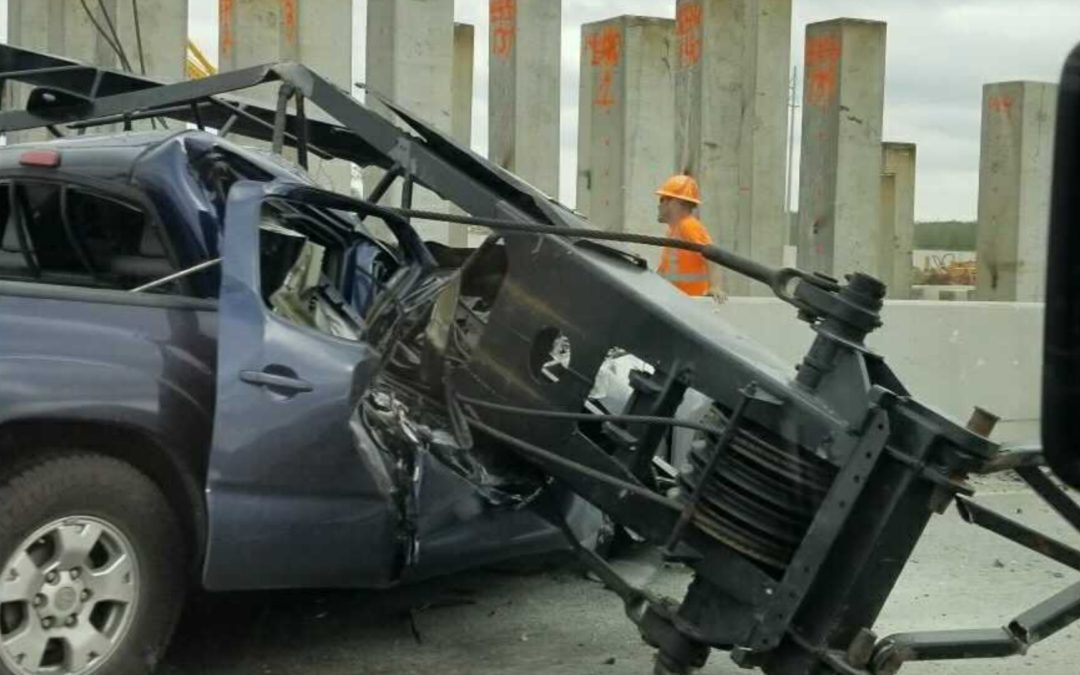 Two Men Killed When Part of a Crane Falls on Their Pickup Truck